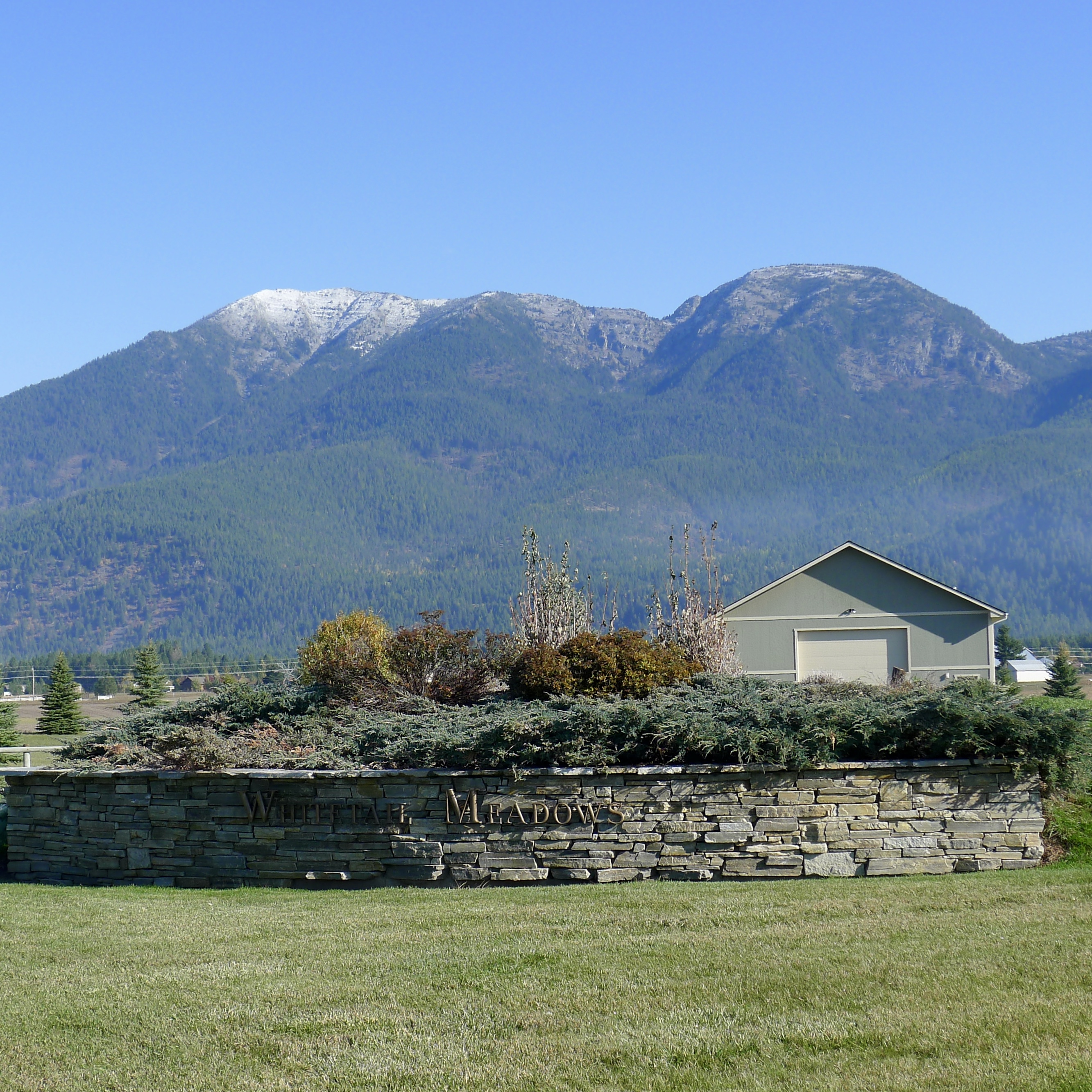 So you want land with views? photo with swan mountains in background