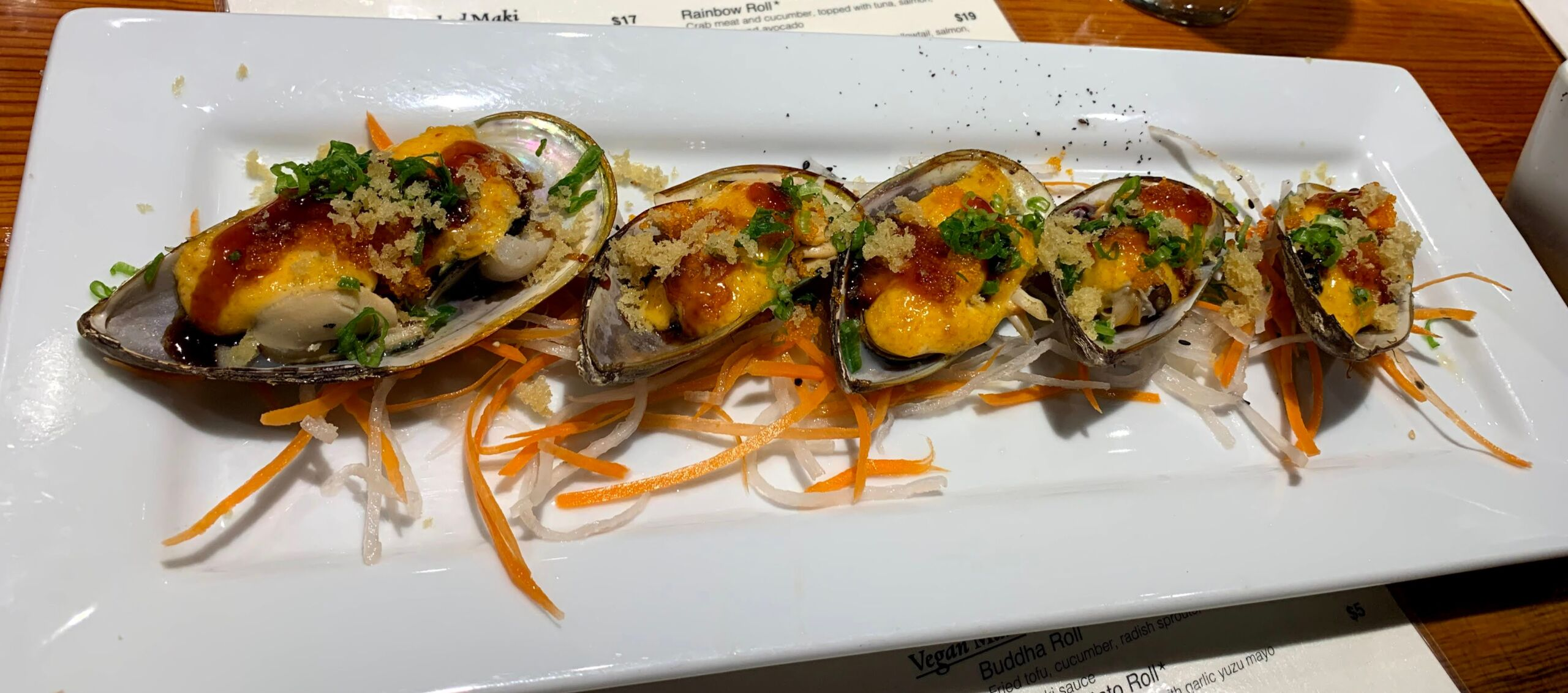 Can you really get good sushi in Kalispell MT? photo of green mussels
